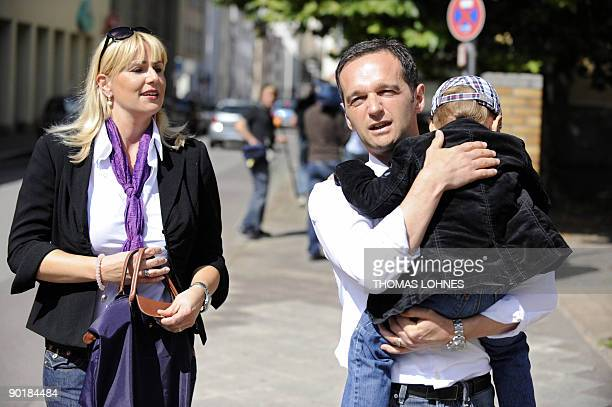 Saarland's Social Democtratic Party candidate Heiko Maas and his wife Corinna and son arrive to cast their votes in the south-western German city of...