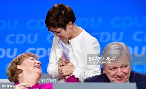 Saarland's State Premier and designated secretary general of the Christian Democratic Union Annegret KrampKarrenbauer shares a laugh with German...