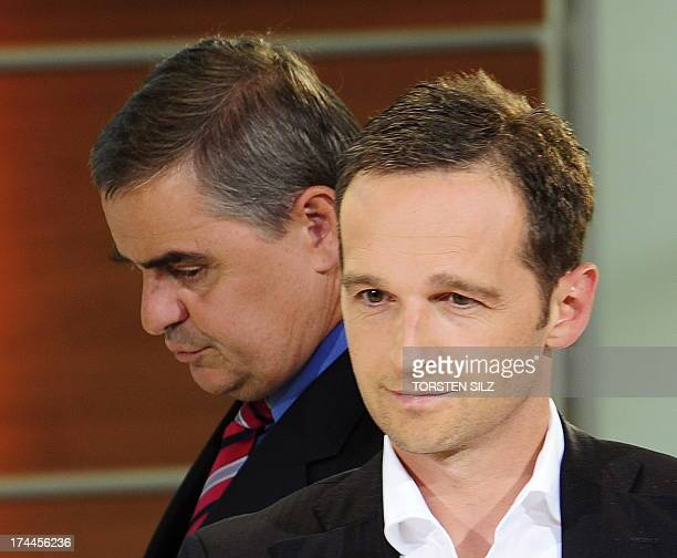 Saarland's State Premier Peter Mueller walks past Saarland's Social Democratic Party candidate Heiko Maas during a television election special in the...