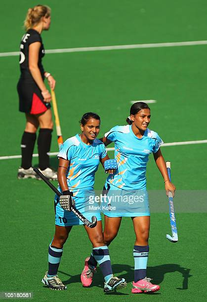 Saba Anjum and Rani Rampal of India celebrate a goal during the Women's Semifinal match between Australia and England at Major Dhyan Chand National...