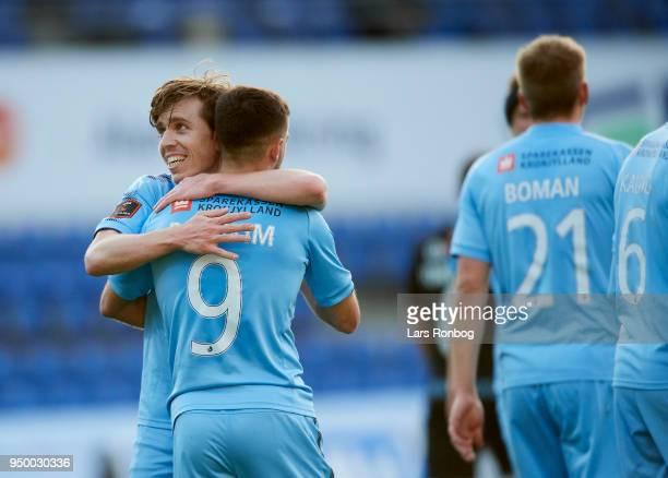 Saba Lobzhanidze and Bashkim Kadrii of Randers FC celebrate after scoring their third goal during the Danish Alka Superliga match between Randers FC...
