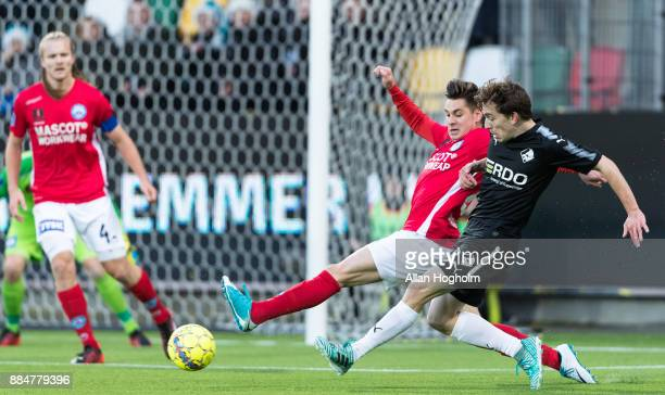 Saba Lobzhanidze of Randers FC and Gregor Sikosek of Silkeborg IF compete for the ball during the Danish Alka Superliga match between Silkeborg IF...