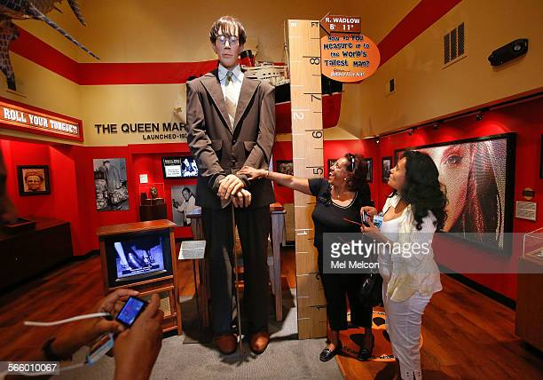 Saba Tesfaye left and friend Mimi Atnafu of Canada check out a manniquin on display at Ripley's Believe It or Not Museum on Hollywood Blvd in...