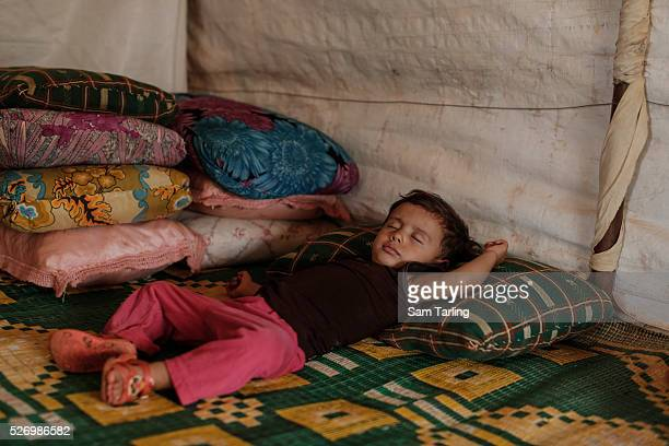 Sabah 18monthsold sleeps in her uncle's tent in which she now lives in Chlifa in the Northern Bekaa Valley Lebanon on September 10 2015 Her father...