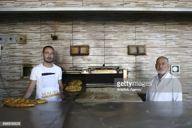 Sabahattin Kahraman a baker poses for a photo with his 36yearold baker son Serhat Kahraman who had chosen the same field of profession with his...