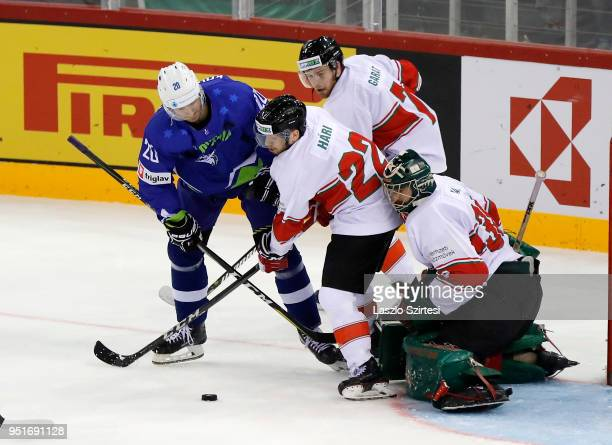 Sabahudin Kovacevic of Slovenia Janos Hari of Hungary Zsombor Garat of Hungary and Adam Vay of Hungary in action during the 2018 IIHF Ice Hockey...