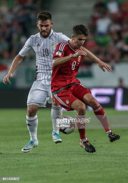 Sabala Valerijs of Latvia in action with Adam Nagy of Hungary during the World Cup qualification match between Hungary and Latvia at Groupama Arena...