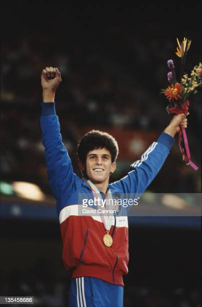 Saban Trstena of Yugoslavia celebrates winning the gold medal in the Men's Flyweight Freestyle Wrestling event on 10th August 1984 during the XXIII...