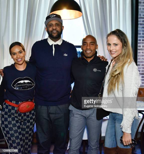 Sabathia Amber Sabathia Tiki Barber and Tracy Lynn Johnson attend the Amber And CC Sabathia and Tiki Barber Cheer On Team 52 Marathon With Haute...
