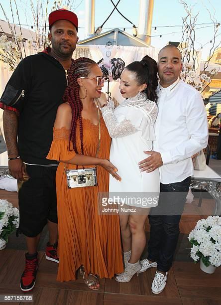 C Sabathia and Amber Sabathia pose with Gia Casey and DJ Envy at a Surprise Baby Shower For Gia Casey Hosted By 50 Cent at STK on July 24 2016 in New...