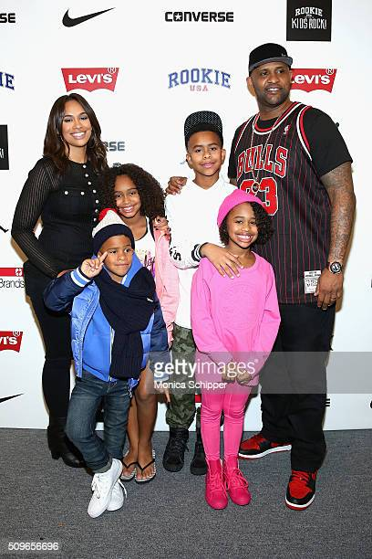 Sabathia and Amber Sabathia pose with their children Carsten Jaeden Cyia and Carter at the Rookie USA Presents Kids Rock Fall 2016 fashion show...