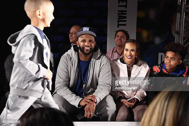 Sabathia and Amber Sabathia watch the runway show during BKLYN Rocks presented by City Point Kids Foot Locker and Haddad Brands at City Point on...