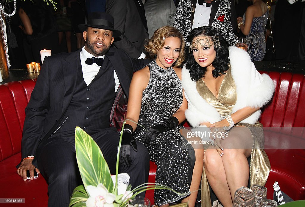 C.C. Sabathia and wife Amber Sabathia pose with Emily B. during Fabolous' The Great Fabsby Birthday Celebration at Jazz Room at the General on November 18, 2013 in New York City.