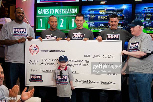 Sabathia Derek Jeter Clay Rapada and Chris Stewart of the New York Yankees pose with Andy Fass while presenting a $10000 check to the National...