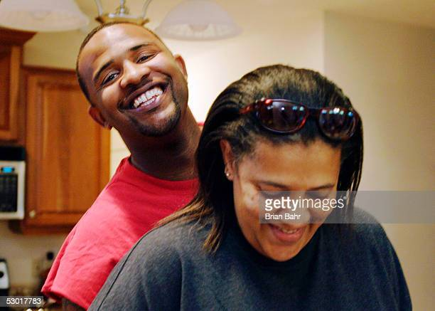 C Sabathia Jr #52 of the Cleveland Indians hugs his mom as she serves up dinner at home after going seven shutout innings against the Tampa Bay Devil...