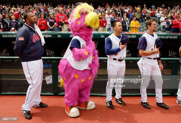 C Sabathia of the Cleveland Indians pauses for the national anthem with the mascot before going seven shutout innings against the Tampa Bay Devil...