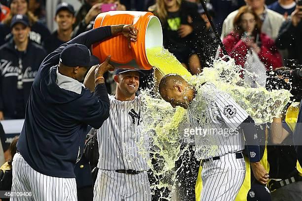 Sabathia of the New York Yankees and Brett Gardner dump Gatorade on Derek Jeter after he hit a game winning RBI hit in the ninth inning against the...