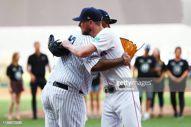 Sabathia of the New York Yankees and Chris Sale of the Boston Red Sox greet each other during the pre-game ceremonies before the MLB London Series...