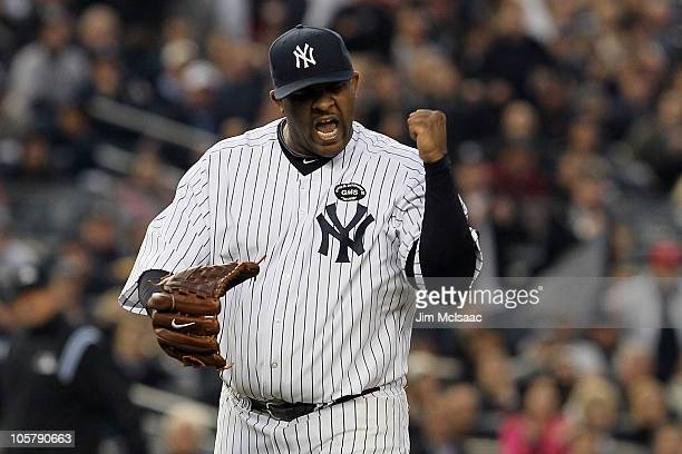 Sabathia of the New York Yankees celebrates after he forced Josh Hamilton of the Texas Rangers to ground into a double play to end the top of the...