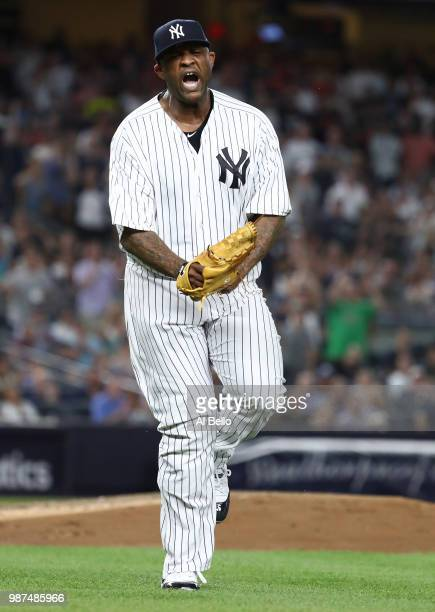 Sabathia of the New York Yankees celebrates after retiring the side in the seventh inning against the Boston Red Sox during their game at Yankee...