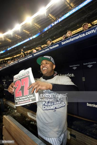 Sabathia of the New York Yankees celebrates in the dugout with a copy of the New York Post after their 7-3 win against the Philadelphia Phillies in...