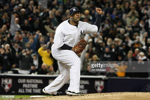 Sabathia of the New York Yankees celebrates striking out Mike Napoli of the Los Angeles Angels of Anaheim to end the seventh inning in Game One of...