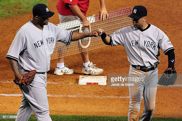 Sabathia of the New York Yankees celebrates with teammate Derek Jeter in Game Four of the ALCS against the Los Angeles Angels of Anaheim during the...