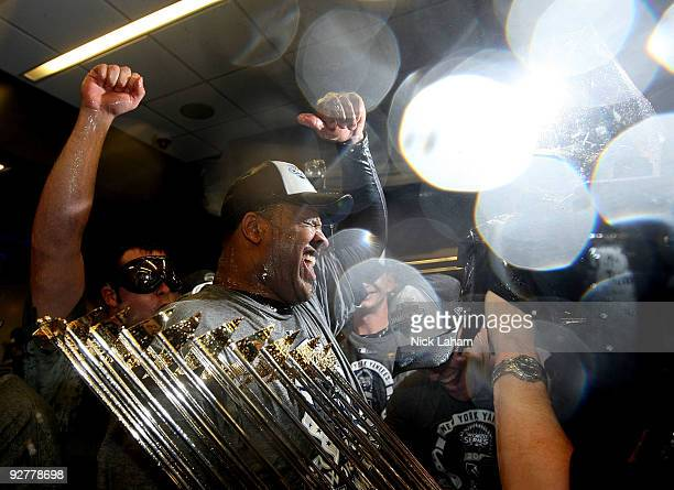 C Sabathia of the New York Yankees celebrates with the trophy in the locker room after their 73 win against the Philadelphia Phillies in Game Six of...