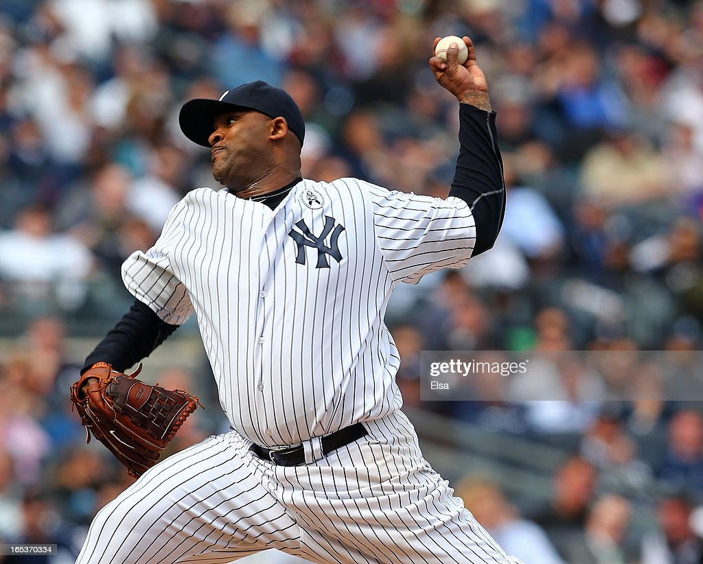 CC Sabathia #52 of the New York Yankees delivers a pitch during Opening Day against the Boston Red Sox on April 1, 2013 at Yankee Stadium in the Bronx borough of New York City.