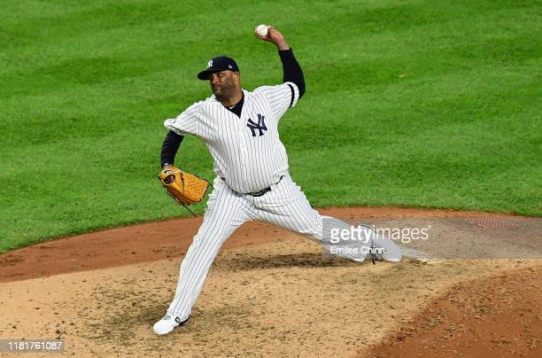 Sabathia of the New York Yankees delivers a pitch in the eighth inning of game four of the American League Championship Series against the Houston...