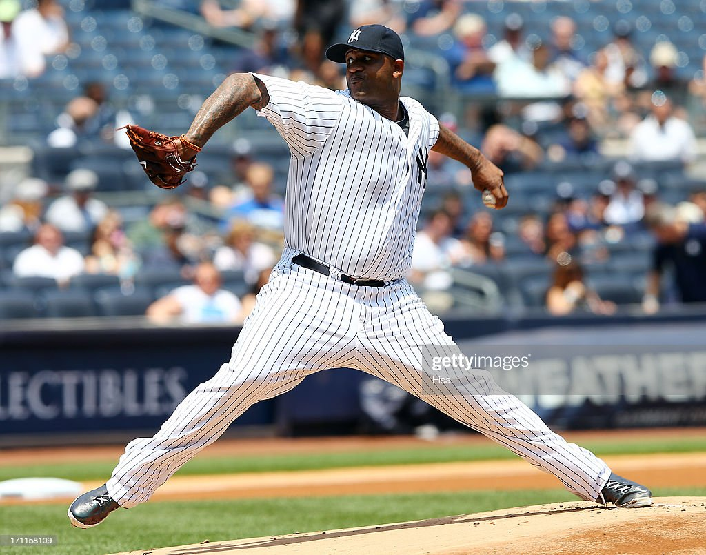CC Sabathia #52 of the New York Yankees delivers a pitch in the first inning against the Tampa Bay Rays on June 22,2013 at Yankee Stadium in the Bronx borough of New York City.