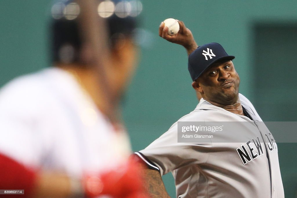 CC Sabathia #52 of the New York Yankees delivers in the first inning of a game against the Boston Red Sox at Fenway Park on August 19, 2017 in Boston, Massachusetts.