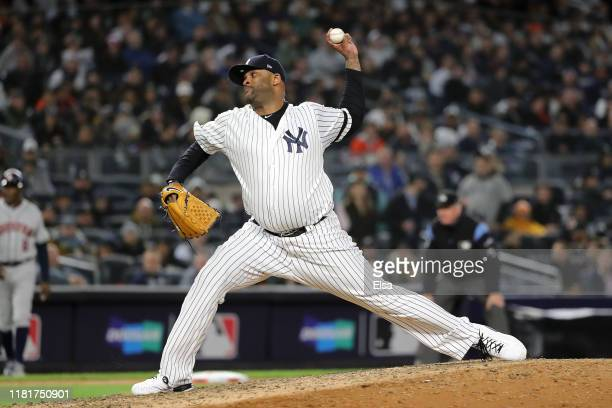 Sabathia of the New York Yankees delivers the pitch against the Houston Astros during the eighth inning in game four of the American League...