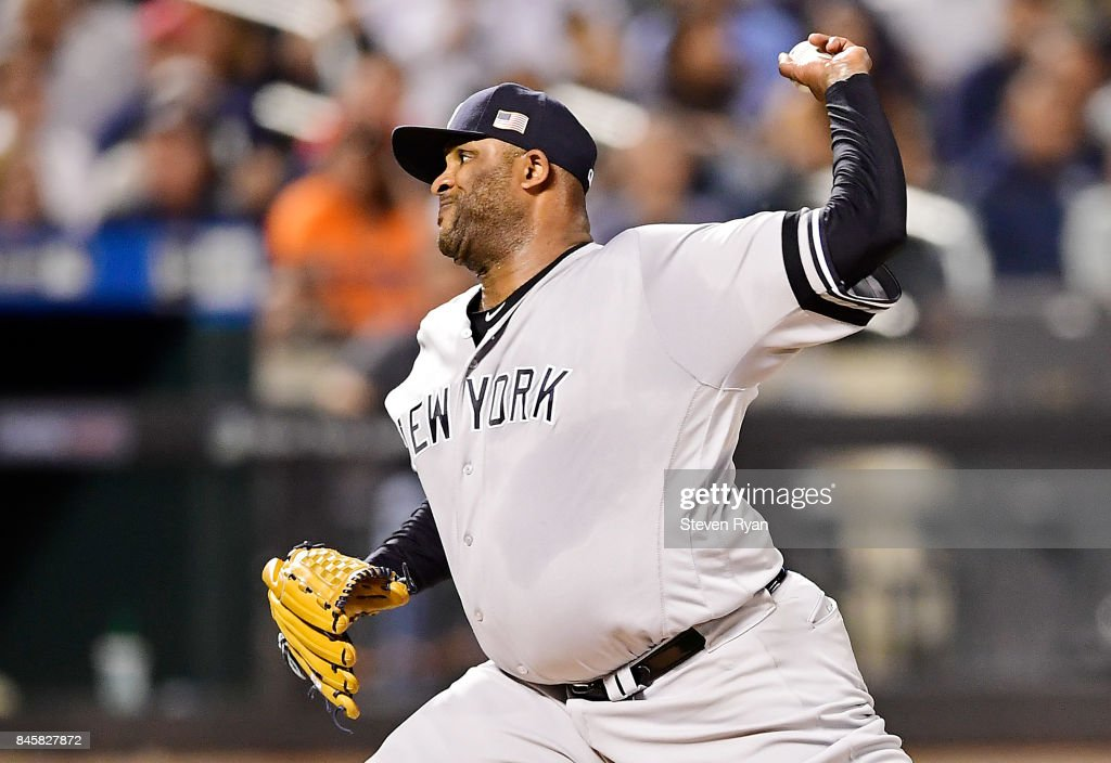 CC Sabathia #52 of the New York Yankees delivers the pitch during the third inning against the Tampa Bay Rays at Citi Field on September 11, 2017 in the Flushing neighborhood of the Queens borough of New York City. The two teams were scheduled to play in St. Petersburg, but due to the weather emergency caused by Hurricane Irma, the game was moved to New York, but with Tampa Bay remaining the 'home' team.