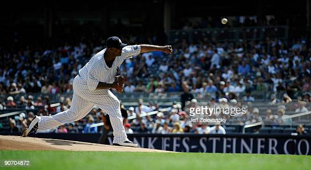 Sabathia of the New York Yankees delivers to the plate in the first inning of a game against the Baltimore Orioles at Yankee Stadium on September 13...