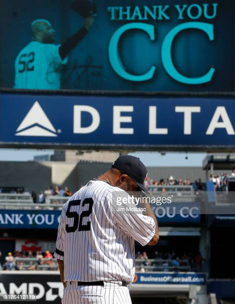 Sabathia of the New York Yankees fights back tears as he is honored prior to a game against the Toronto Blue Jays at Yankee Stadium on September 22,...