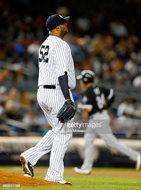 Sabathia of the New York Yankees looks on after surrendering a seventh inning home run against Mike Olt of the Chicago White Sox at Yankee Stadium on...