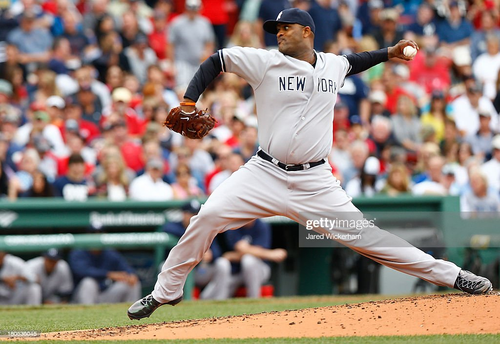 CC Sabathia #52 of the New York Yankees pitches against the Boston Red Sox in the second inning during the game on September 14, 2013 at Fenway Park in Boston, Massachusetts.