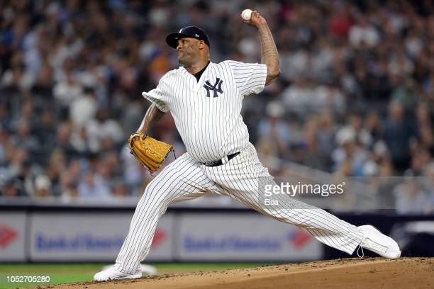 C Sabathia of the New York Yankees pitches in the first inning against the Boston Red Sox during Game Four American League Division Series at Yankee...