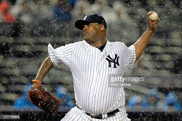 Sabathia of the New York Yankees pitches in the rain against the Detroit Tigers during Game One of the American League Division Series at Yankee...