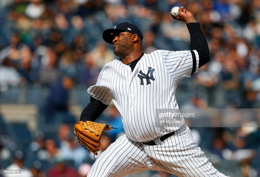 CC Sabathia #52 of the New York Yankees pitches in the second inning against the Toronto Blue Jays at Yankee Stadium on September 30, 2017 in the Bronx borough of New York City.