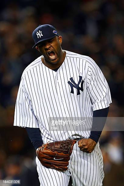 Sabathia of the New York Yankees reacts after getting out of the eighth inning against the Baltimore Orioles during Game Five of the American League...
