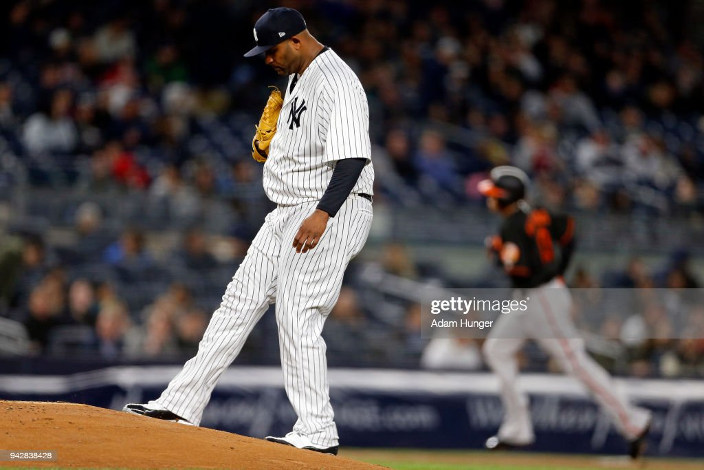CC Sabathia #52 of the New York Yankees reacts after giving up a solo home run to Manny Machado #13 of the Baltimore Orioles during the third inning at Yankee Stadium on April 6, 2018 in the Bronx borough of New York City.