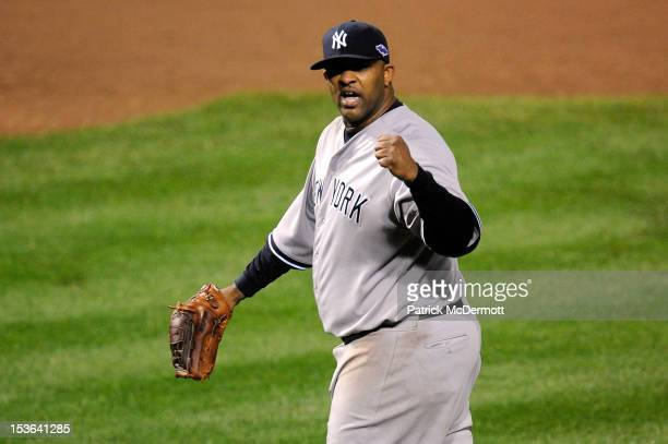 Sabathia of the New York Yankees reacts after Mark Reynolds of the Baltimore Orioles grounded out for the final out in the bottom of the eighth...