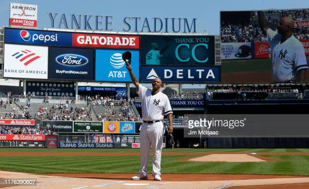 Sabathia of the New York Yankees salutes the crowd as he is honored prior to a game against the Toronto Blue Jays at Yankee Stadium on September 22...