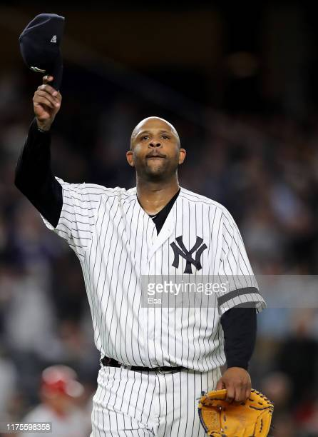 Sabathia of the New York Yankees salutes the fans as he is pulled from the game in the third inning against the Los Angeles Angels at Yankee Stadium...