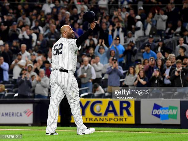 Sabathia of the New York Yankees salutes the fans as he is pulled from the game in the third inning against the Los Angeles Angles at Yankee Stadium...