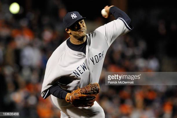 Sabathia of the New York Yankees throws a pitch against the Baltimore Orioles during Game One of the American League Division Series at Oriole Park...