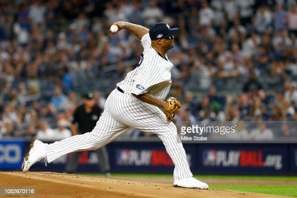 Sabathia of the New York Yankees throws a pitch against the Boston Red Sox during the first inning in Game Four of the American League Division...