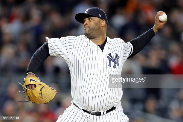 Sabathia of the New York Yankees throws a pitch against the Houston Astros during the first inning in Game Three of the American League Championship...